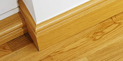 Wood skirting board fitting